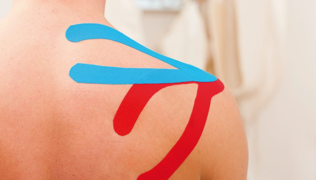 Patient at the physiotherapy with tape